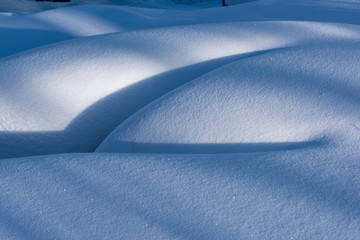 snow covered boulders in winter
