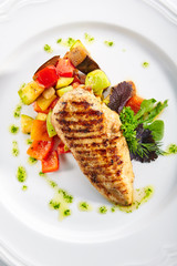 Macro Shot of Grilled Chicken Fillet with Side Dish of Baked Vegetables