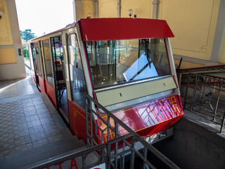 Foto op Aluminium Londen rode bus Bergamo, Italy. The red funicular at the upper station of San Vigilio. It is a cable car that connects the old town to the highest neighborhood in the city