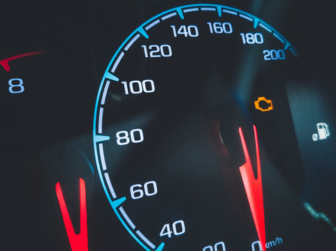 Close-up of speedometer of car dashboard panel