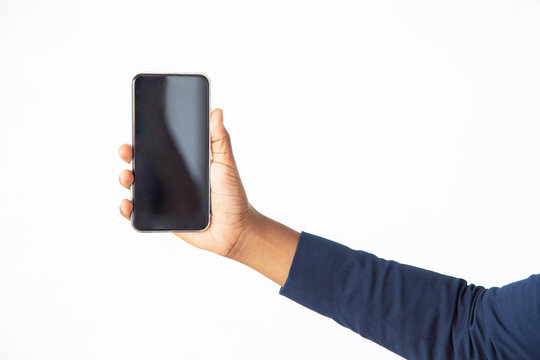 Businesswoman showing blank cellphone screen. Closeup of female hand holding mobile phone. Advertising or communication concept