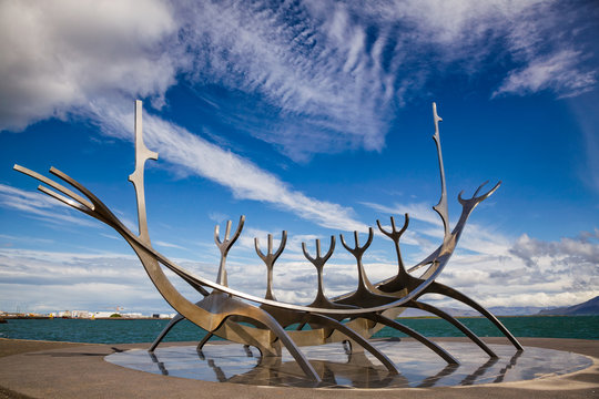Reykjavik, Iceland - July 20, 2015: The Sun Voyager or Traveler (Solfar) stainless steel ship-like sculpture by Jon Gunnar Arnason, one of the most famous sculptures in Reykjavik  located on the seafr