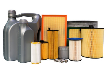 Oil filter, air filter, cabin filter, spark plugs, oil cans. Spare parts of a car on a white background. isolated.