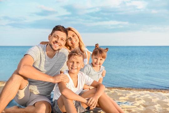 Portrait of happy family on sea beach