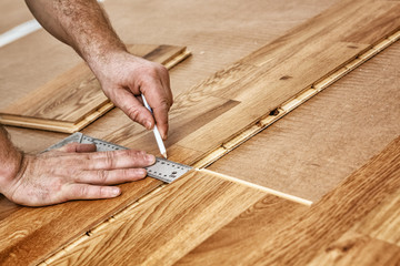 Parquet recliner, Craftsman installing engineered click system oak wood flooring
