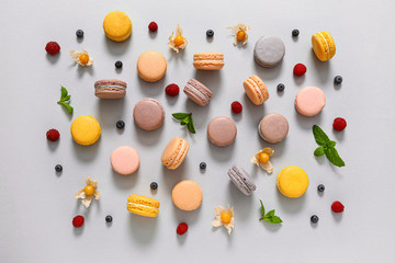 Assortment of tasty macarons on grey background
