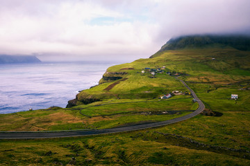 Wall Mural - Road going to Gasadalur village in Faroe Islands