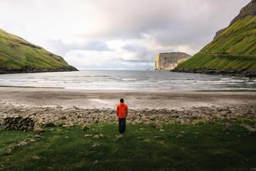 Wall Mural - Tourist standing at the beach in Tjornuvik in the Faroe Islands, Denmark