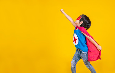 Portrait of asian little boy playing pretend to superhero. Happy young cut boy wearing hero costume, education childhood lifestyle, back to school concept