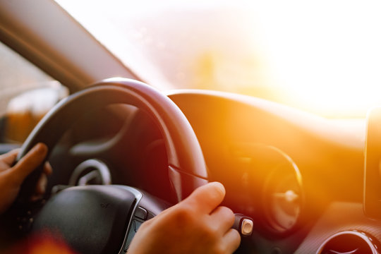 Close up of driver hands driving in road trip