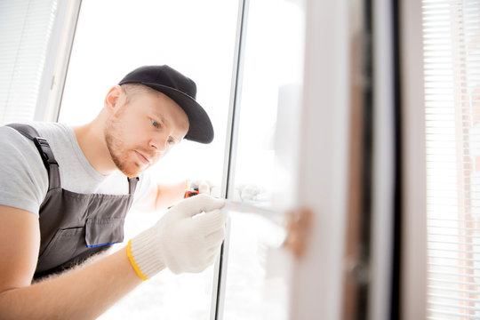 Master worker measures upvc window with ruler, installation process