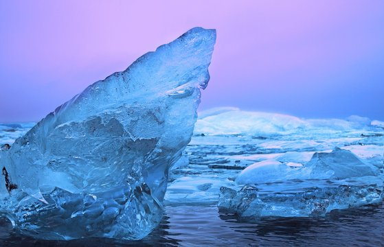 Frozen lake during winter with pieces of ice on the cold surface