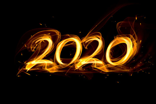 2020 date of fire, smoke and sparks on a black background