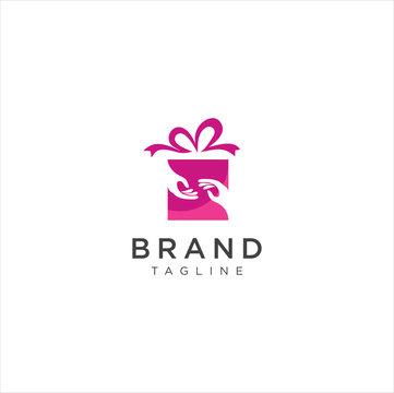 Christmas Gift Logo . Hand Gift Logo Stock Vectors . We Gift Logo Design Vector Stock . Gift Store Shop Logo Template  . Surprise Gift Shop Logo