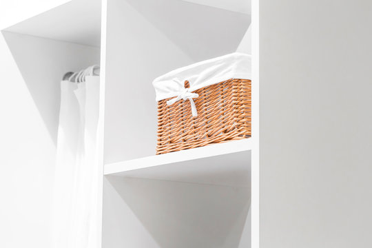Details and elements of the interior, domestic life. Organization of home space, order and cleanliness in the closet for things. Box for neat storage of clothes. Furniture in the wardrobe