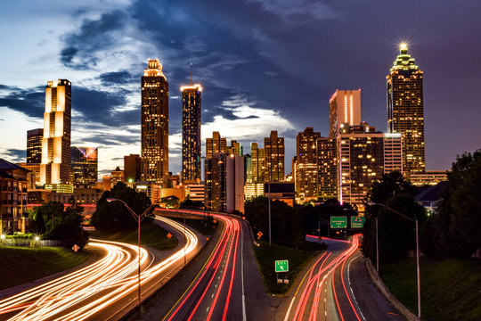 Skyline of Downtown Atlanta and Blurred Highway Traffic at Dusk - Atlanta, Georgia, USA