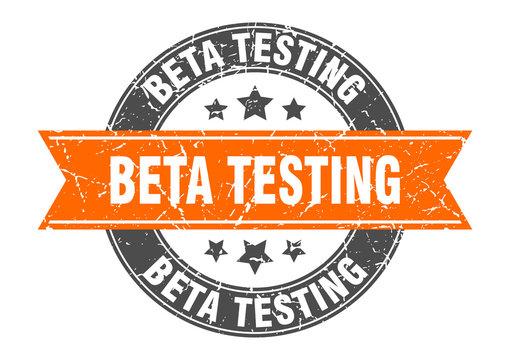 beta testing round stamp with orange ribbon. beta testing