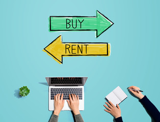 Buy or rent concept with people working together with laptop and notebook