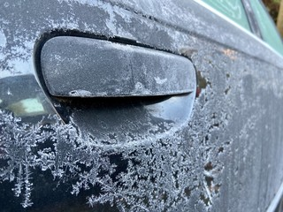 Frozen car early in the morning  during cold winter season