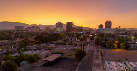 Fotobehang Lavendel Orange Sunrise Aerial Perspective Downtown City Skyline Albuquerque New Mexico
