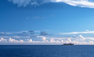 Wall Mural - Cruise ship sailing on blue ocean