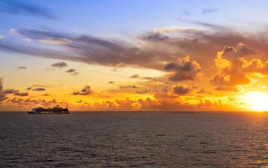 Wall Mural - Cruise ship sailing into sunset