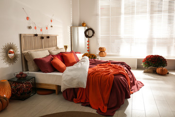 Cozy bedroom interior inspired by autumn colors