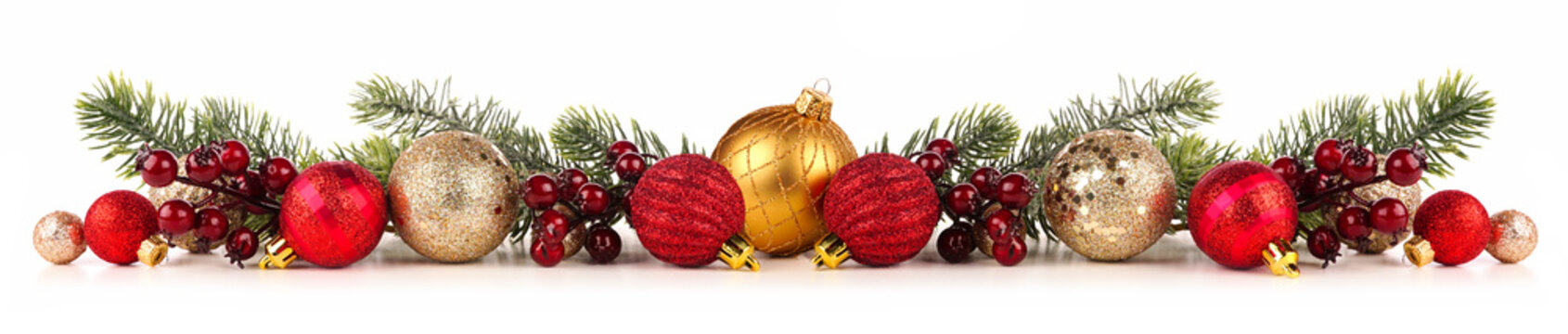 Christmas border of red and gold ornaments with branches. Side view isolated on a white background.