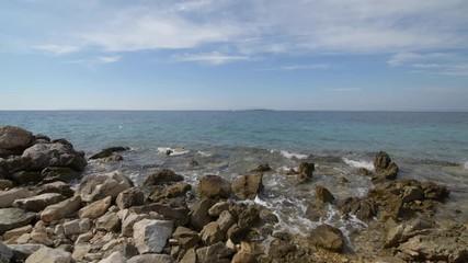 Wall Mural - Croatian Adriatic Sea Scenery. Mediterranean Sea Coast During Summer Day. Small Yacht on the Horizon.