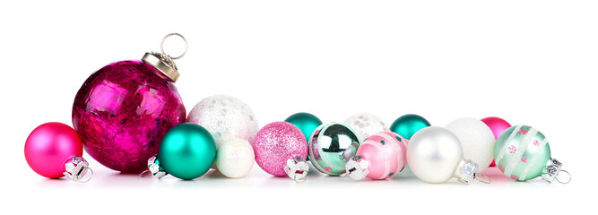Wall Mural - Christmas border of pink, teal and white ornaments. Side view isolated on a white background.