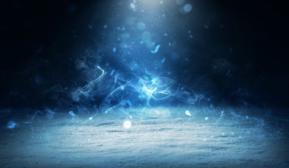 Winter abstract, blurred background with bokeh. Blurry night city lights in reflection on a snowy road. Neon light, falling snow, snowflakes. Wall mural
