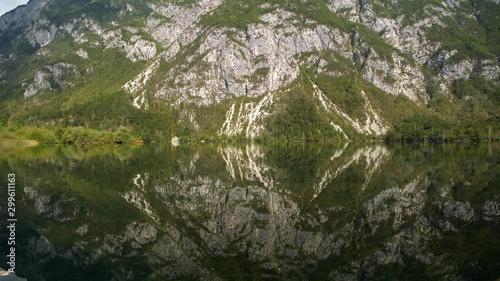 Wall mural Part of Triglav National Park. Scenic Lake Bohinj in the Slovenia. Fall Season at the Lake.