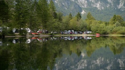 Wall Mural - September 17, 2019, Upper Carniola Region of Slovenia. Lake Front Camping in the Triglav National Park. Lake Bohinj in the Slovenia. Bohinj Valley of the Julian Alps.