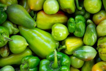 Green organic Tomatoes In Market  closeup Tomato Vegetable