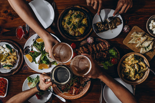 delicious European and Slavic cuisine on the big table. Group of people eating at table. table with food, top view
