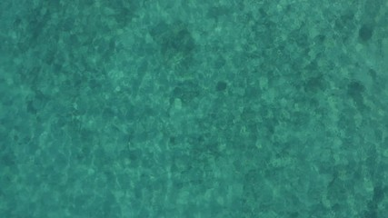 Wall Mural - Tropical Place Turquoise Bay Water of the Sea. Natural Background Aerial Footage.