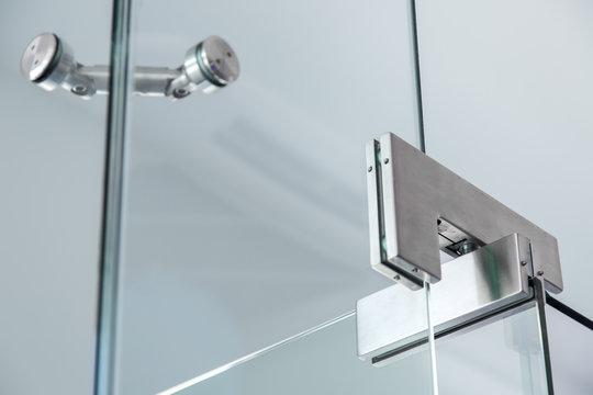 glass door pivot hinge fittings, close up.