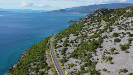 Wall Mural - Aerial Footage of Croatian Scenic Coastal Highway and Turquoise Waters of the Mediterranean Sea