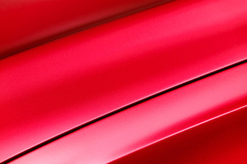 Red car bodywork, detail of hood and fender of sport sedan, automobile industry, selective focus, abstract