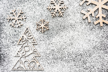 Creative winter snowflakes and fir-tree from powdered sugar Christmas and New Year backgrounds.