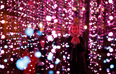 A woman takes photographs in an installation called 'submergence'  which forms part of the River of Light festival in Liverpool, Britain