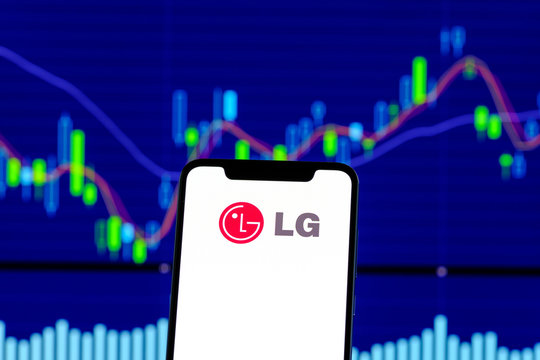 LG logo is seen on an smartphone over stock chart
