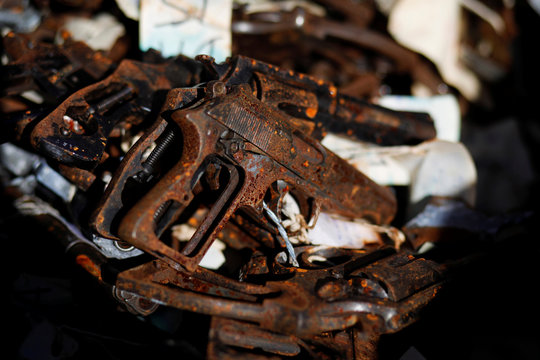 Rust weapons, part of a batch of 1500 weapons seized and used in different crimes, are seen in a container before being destroyed in a foundry in Quezaltepeque