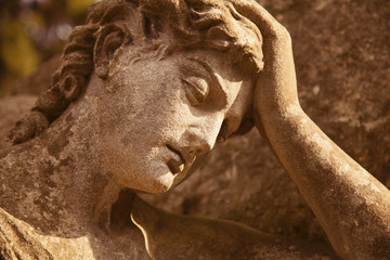 Fototapete - Death. Close up antique statue of sad angel as symbol of pain and end of life.