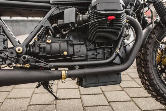 Close up detail of a powerful vintage motorcycle - large carburetor engine