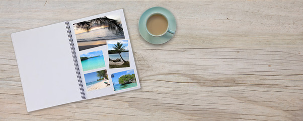 Banner Photobook Album on Deck Table with Travel Photos and Coffee or Tea in Cup