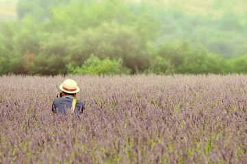 Photographer taking pictures in the middle of the lavender field