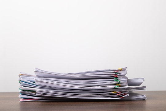 Stack of overload document paper with copy space.