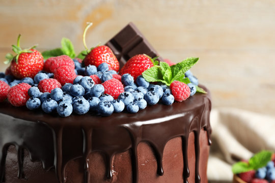 Delicious chocolate cake decorated with fresh berries, closeup