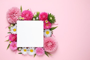 Flat lay composition with beautiful aster flowers and blank card on pink background. Space for text